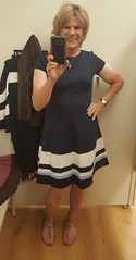I love fit and flare dresses and I did not have a navy one.  In Stienmart dressing room