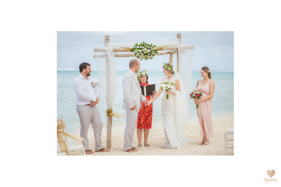 tropical wedding invitiationei katu, head garland, tropical, Rarotonga, wedding bandsdocumentary, bridal preptropical wedding gown, bridal portrait, Nautilus Resortwedding attendants, flower girl, page boy, island weddingKuras Kabanas Rarotongagroom prep, grey linen suitgroom portrait, Avana harbour, Rarotongabeach wedding at the Nautilus Resort Rarotongabeach processional, Nautilus Resort Rarotongabeach wedding, vow exchangebeach ceremony wedding arch, Rarotonga