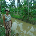 Daw Aye Win standing next to her family's pond while talking about the benefits of adapting aquaculture technologies, which she learned from the MYNutrition project in Myanmar. Photo by Quennie Rizaldo.
