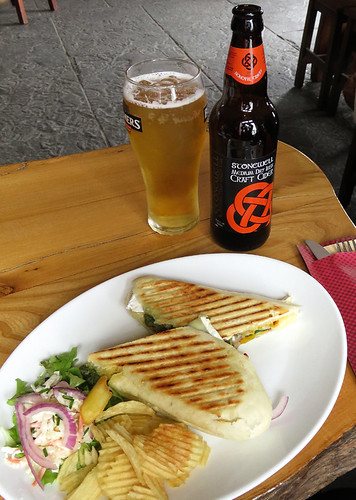 Having a panini of roasted peppers, red onion, Brie, spinach and pesto along with a Stonewell craft cider at the pub on the Aran Island of Inisheer in Ireland