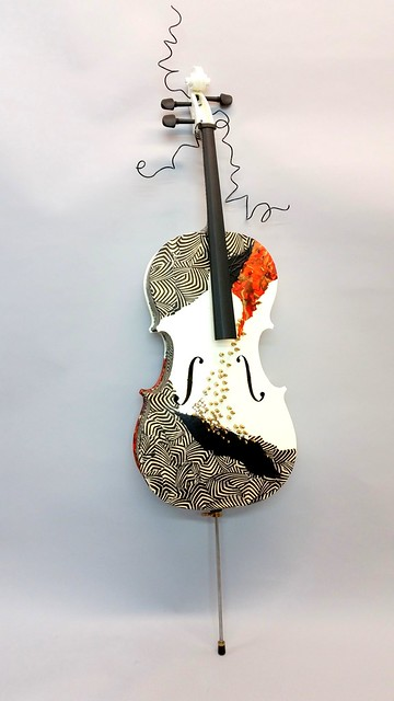 2Yoshii There Is a Crack in Everything mixed media with discarded cello, brass, misc. papers, wire, pain