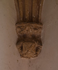 south porch: angel holding a shield with a saltire cross of St Andrew