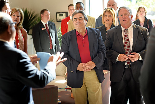 Board of Governors' Bob Rucho (center) and Randy Ramsey listen about nonwovens while touring Centennial Campus.