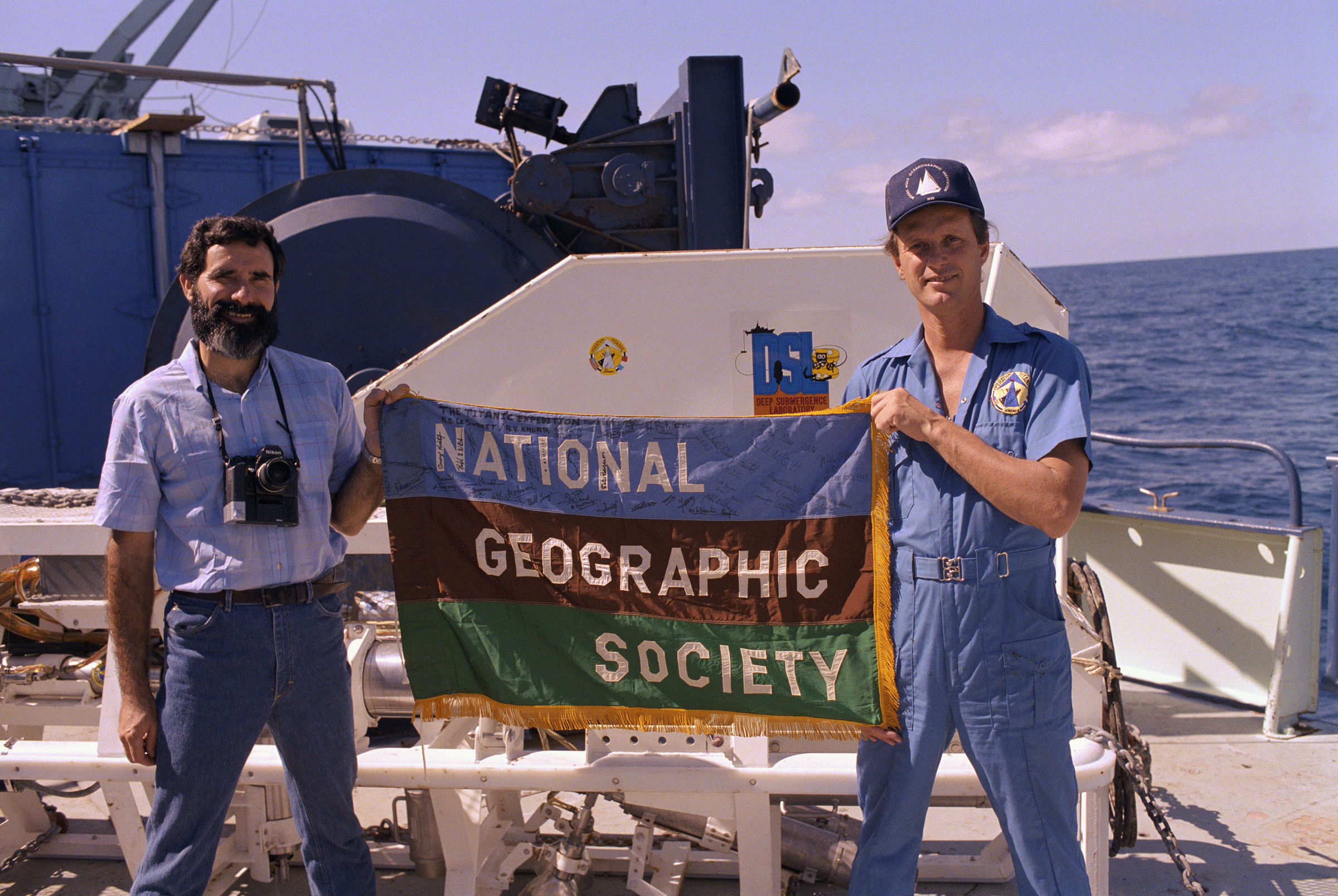 Robert Ballard (right) with National Geographic flag