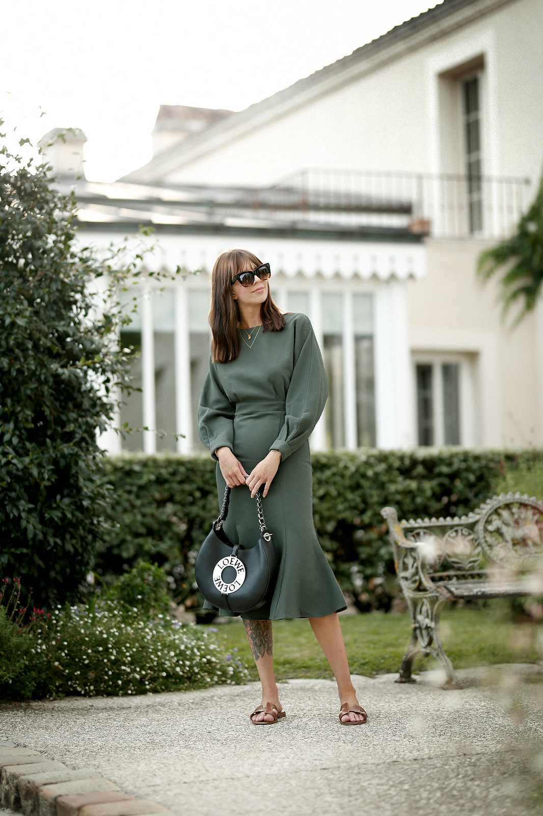 outfit green dress loewe joyce bag breuninger celine sunglasses les sources de caudalie france bordeaux late summer look going out dinner style hermes oran sandals brown minimal french chic parisienne bangs brunette france cats & dogs fashion blogger 7