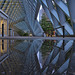 Puddle Reflection at Seattle Public Library by Paul Scearce
