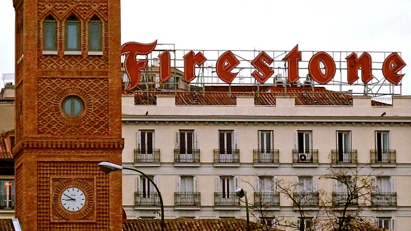 What happened to the iconic Firestone mark behind the Aguirre School in Madrid, Spain