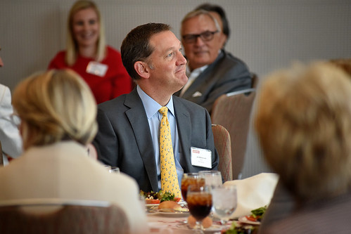 Red Hat CEO Jim Whitehurst smiles at a chancellor's joke at a lunch for the Board of Governors and local business leaders on campus.