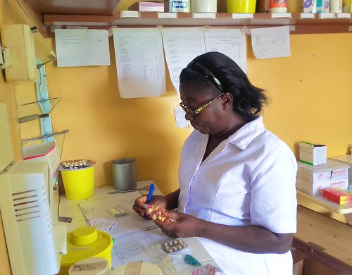Veronica Buah SSL dispensing drugs at Oku Clinic