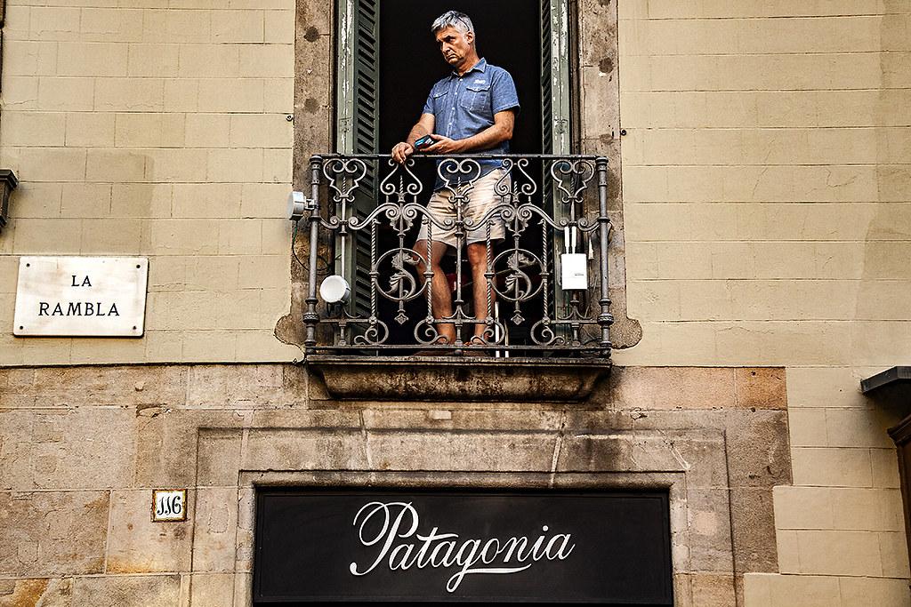 Man on balcony on La Rambla--Barcelona