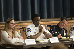 During a forum at Chase Elementary School to discuss police response times, Rep. Stephanie E. Cummings, R-74th District, Waterbury Police Chief Vernon L. Riddick Jr. and Assistant Deputy Chief Edward Appicella listen intently as residents offer their feedback, suggestions and complaints.