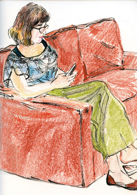 Kate and phone on red sofa