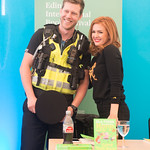 A delighted police officer meets Isla Fisher at her book signing |