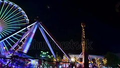 Attraction pendulum. Time lapse. Night attraction.