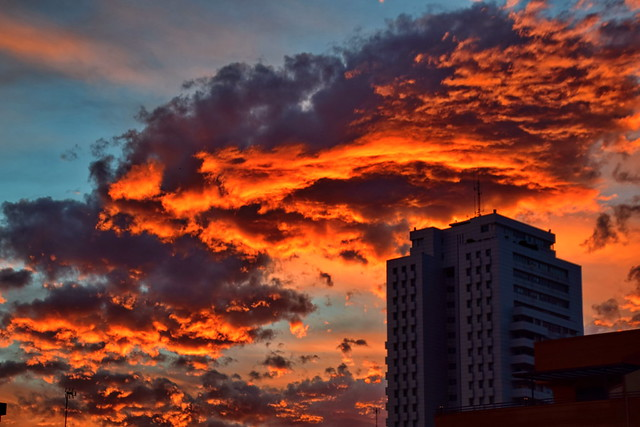 Burning clouds over the city