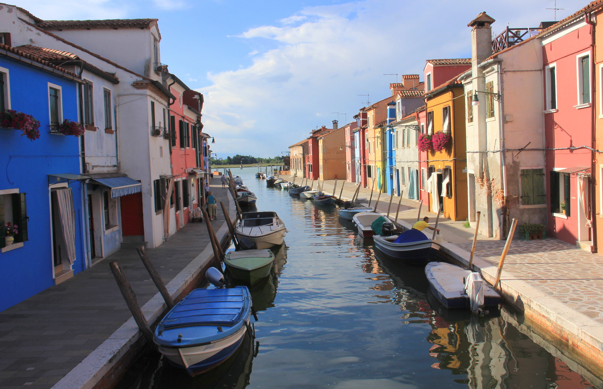 Colourful houses of Burano reflecting on the canals