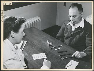 Private A.L. Pehud is treated by nurse Mrs. H.L. Mitcheltree in the neuro speech therapy department... / Le soldat A.L. Pehud est soigné par l'infirmière H.L. Mitcheltree dans le département d'orthophonie neurologique...