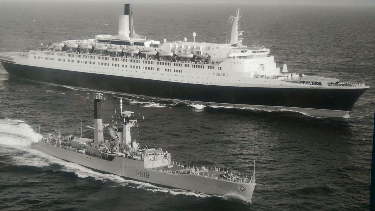 QE2 with Royal Navy escort somewhere in the South Atlantic Ocean, late May 1982.