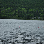 Man swimming across a loch