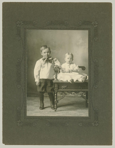 Two boys and a chair