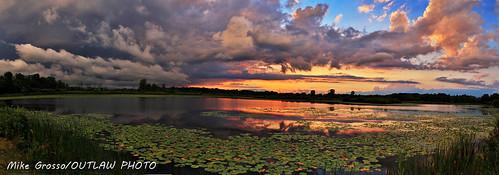 crosswindssunset7717 scenics sunsets sky stormfront waterwinterwonderland waynecountymichigan waynecountyparks dramaticsky sun water lakes landscape crosswinds marsh crosswindsmarsh theweatherchannel