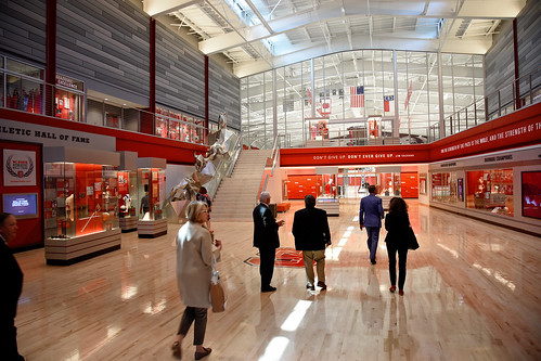 Members of the Board of Governors walk through Reynolds Coliseum during a campus tour.