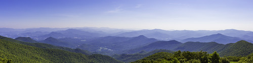 brasstownbald georgia peak mountains forest woods trees town lake water hills misty hazy haze blue sky clouds panorama