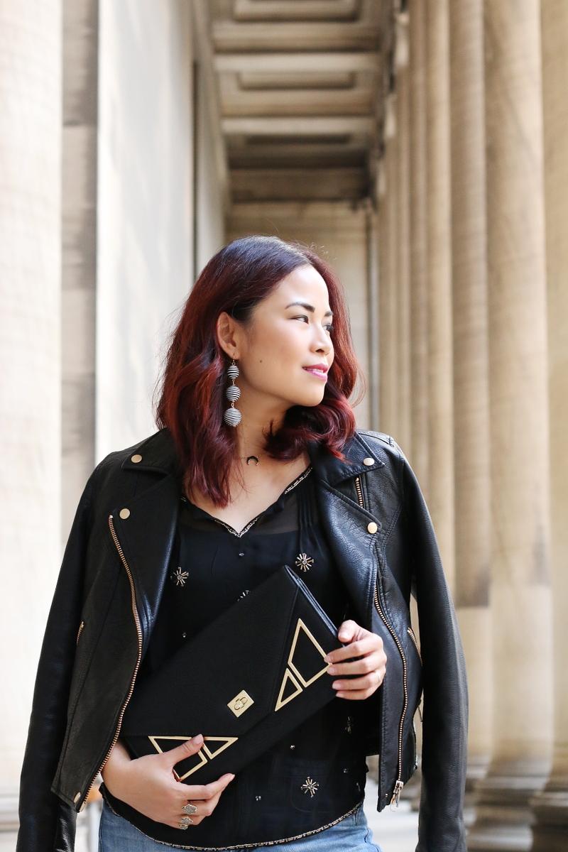 leather-jacket-clutch-sheer-blouse-drop-earrings-11