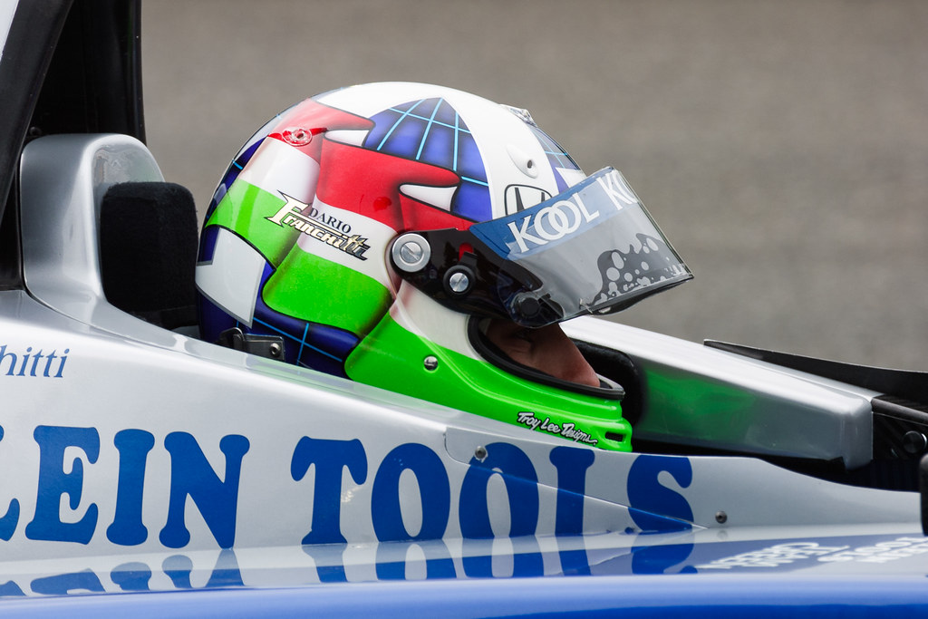 Dario Franchitti sits in his Team KOOL Green car during Sunday practice before the 2002 CART race at Portland International Raceway