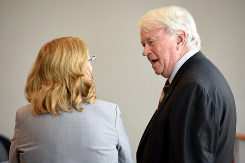Board of Governors' chair Louis Bissette (right) chats with Raleigh mayor Nancy McFarlane before a lunch in Talley Student Union.