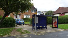 Bus shelter blocking drive way