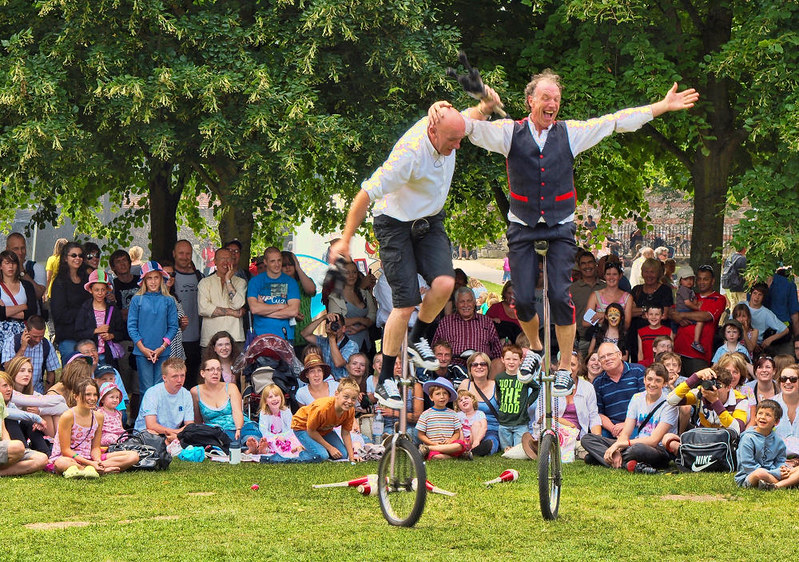 Unicycle jugglers entertain the crowd in the Cathedral Close. Credit Anguskirk, flickr