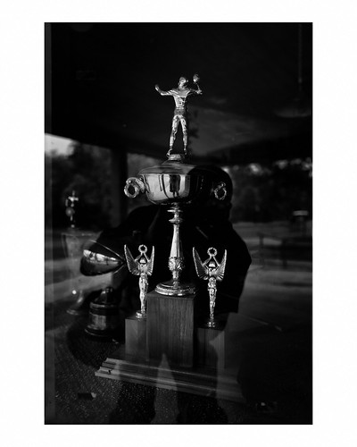Old trophies in storefront window