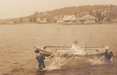 NW Onekama Manistee MI RPPC 1914 BEACH BABES and Water FUN Summer Homes and Resort Hotels on Portage Lake near the Village to the North and Portage Point Inn Resort to the South-