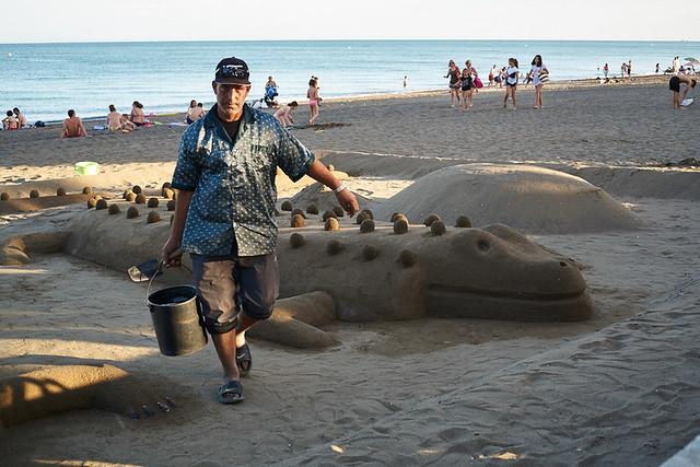 Spanish man making sand sculpture, Pacífico barrio, Malaga, Spain