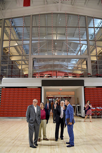 Chancellor Randy Woodson (center) proudly shows off the new Reynolds Coliseum to members of the Board of Governors.