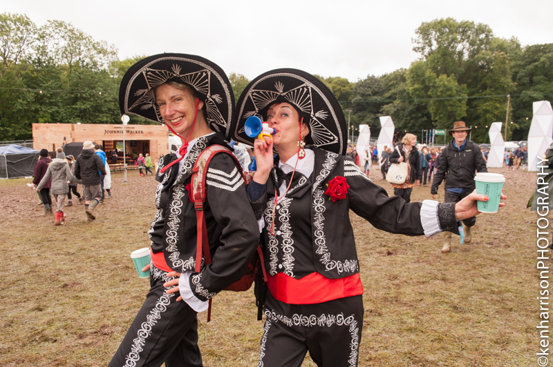 Festival Goers in Fancy Dress brave the muddy conditions at Festival Number 6, Portmeirion, Wales 10th September, 2017.