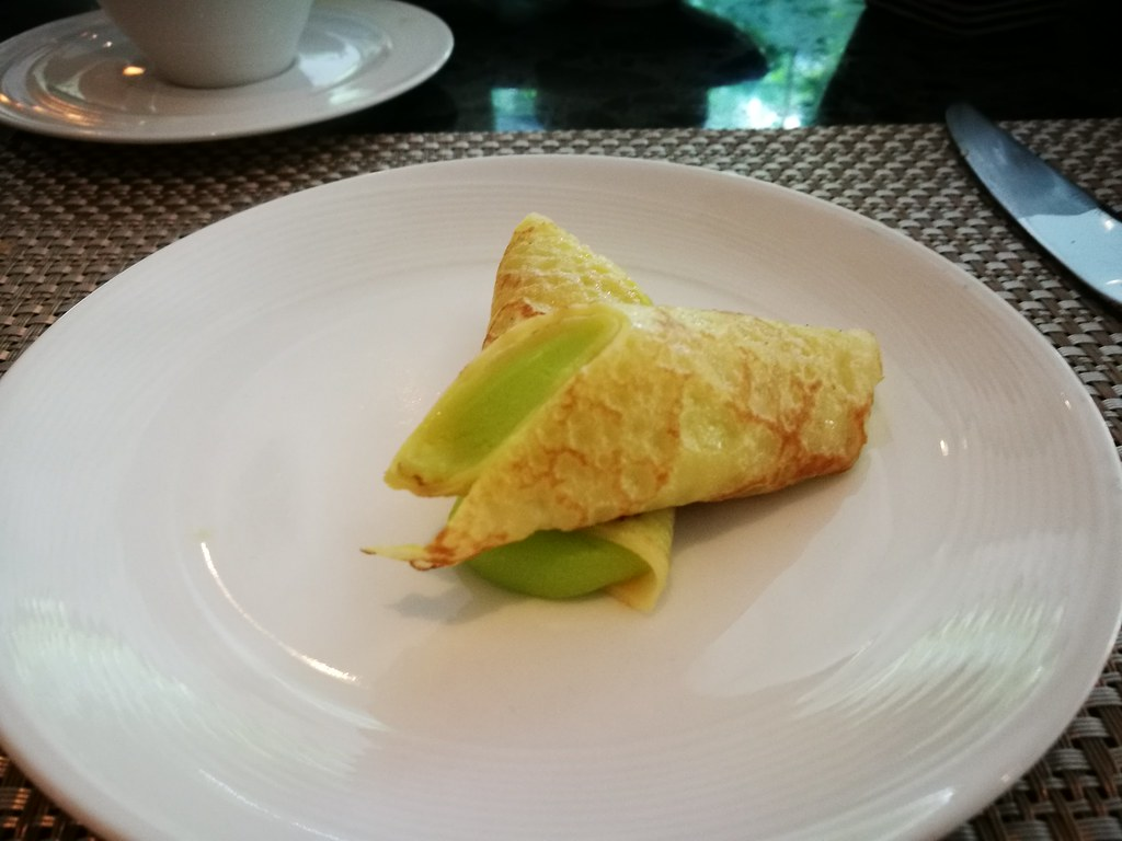 Pandan crepe with candied pomelo