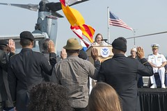 Soldiers and civilians take the oath of allegiance during a naturalization ceremony on the flight deck of San Antonio-class amphibious transport dock ship USS Anchorage (LPD 23), Aug. 4. (U.S. Navy/MC2 Matthew Dickinson)