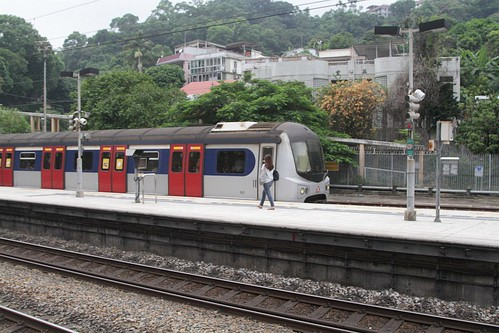 Northbound train takes the 'loop' platform at Sha Tin, main line clear for a Through Train to overtake