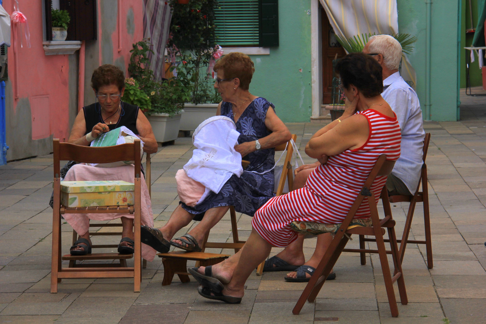 Women making lace in Burano island in Italy
