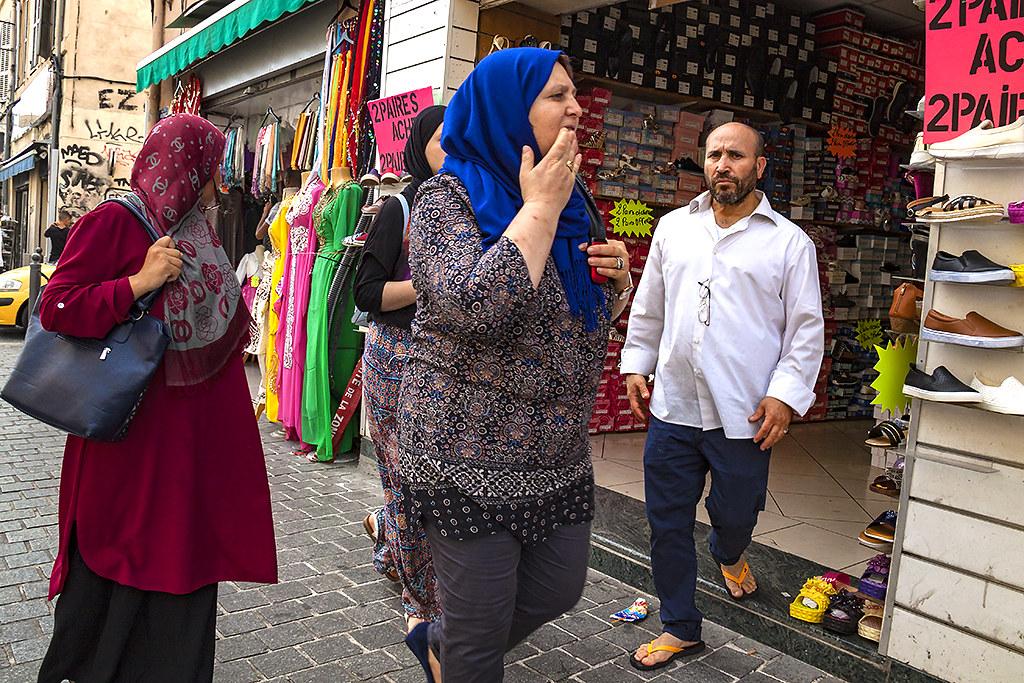 Muslim women walkin by shoe store--Marseille