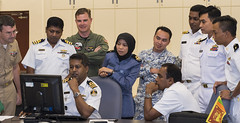 In this file photo, liaison officers coordinate exercise activities in Singapore during SEACAT 2017. (U.S. Navy/MC2 Joshua Fulton)