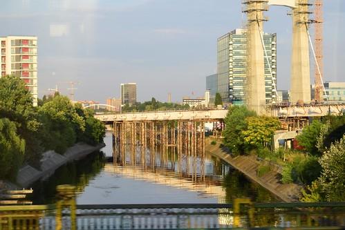 reflection motion buildings river bridge cityscape bucharest trees 7dwf streetshot