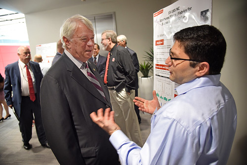 Board of Governors' chair Louis Bissette (left) listens to a researcher about nonwovens while touring Centennial Campus.