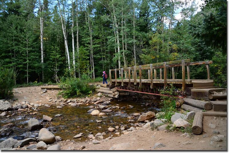 A  wooden bridge crossing the creek