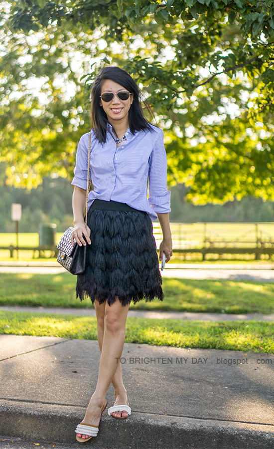 blue striped top with scallops, black fringe skirt, black shoulder bag, fringe flats with embellishments
