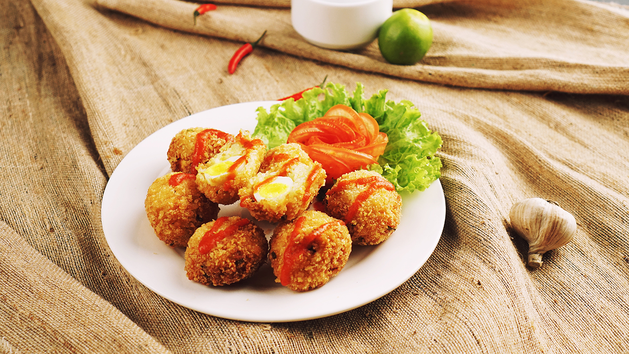 Crispy Fried Quail Egg Wrapped in Cooked Rice