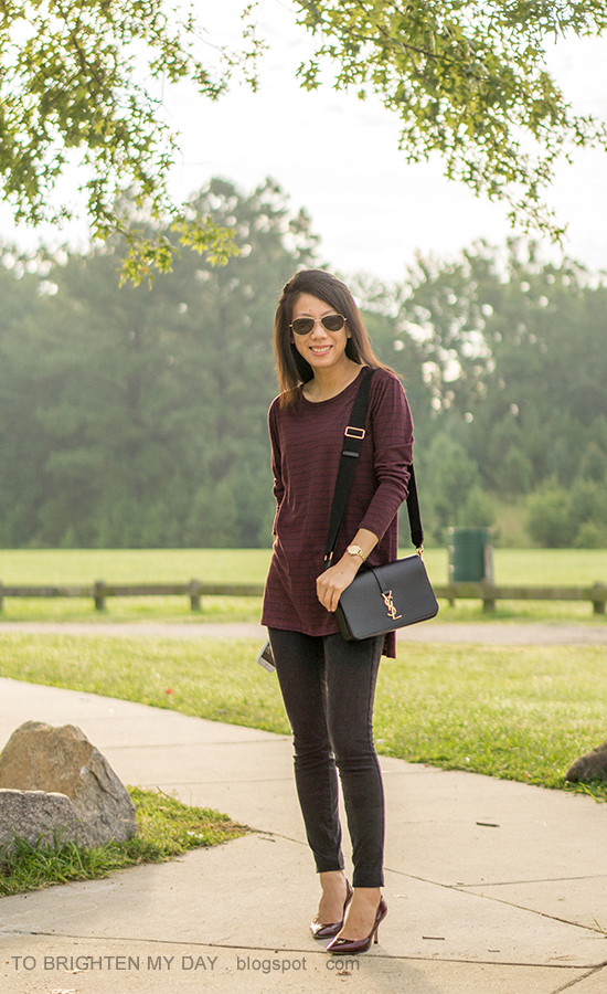 burgundy and navy striped tunic top, black skinny jeans, gold watch, black shoulder bag, burgundy pumps