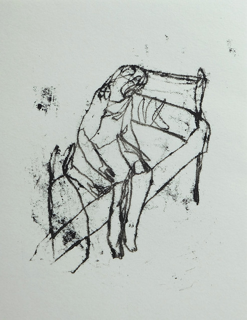 woman seated on a bed